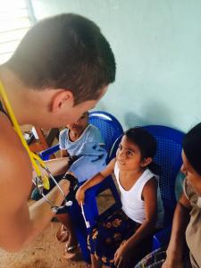 Here is a picture of me giving Vitamin A to a girl on my medical mission trip to Belize this past summer, something I got involved with through a Nazareth Alumni.